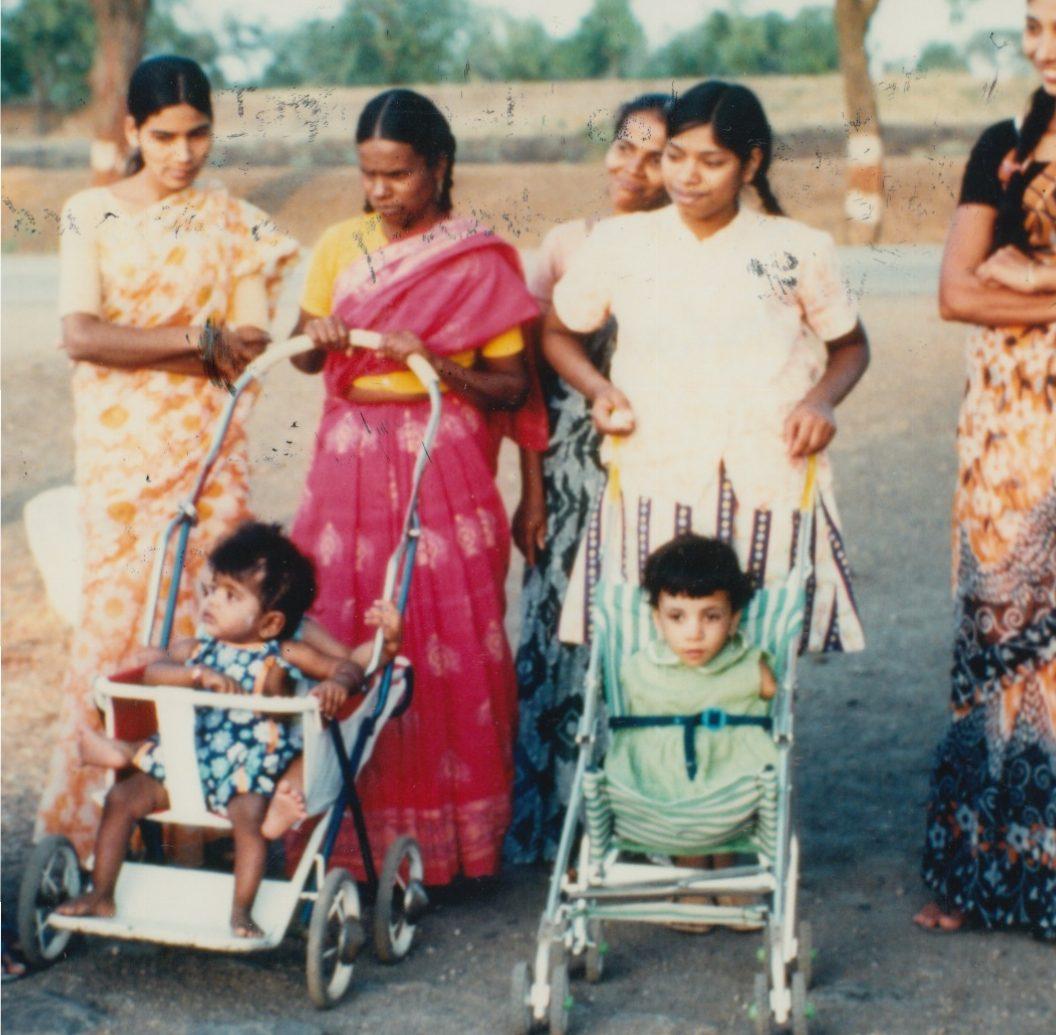 5 - Lisa in stroller age 2